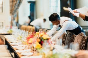 Catering Reps Preparing a Table for an Event